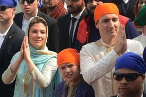 Canada Prime Minister Justin Trudeau (R) and his wife Sophie Gregoire (L) and son Xavier (C) visit the Sikh Golden Temple in Amritsar on February 21, 2018.