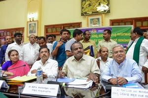 Karnataka chief minister HD Kumaraswamy, his deputy G Parameshwara and chief secretary Ratnaprabha (left) during a meeting with farmers on the issue of loan waivers, in Bengaluru.