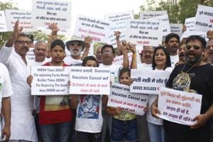 Ardee City residents protest against Haryana government demanding improvement in electricity supply, in Gurugram, on June 2, 2018.