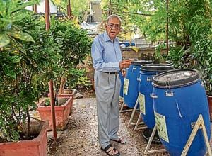 CK Narula shows the compost pit installed in his society.