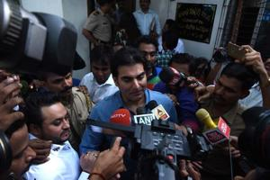 Actor Arbaaz Khan talks to press outside Thane Anti Extortion Cell in Thane on June 2.