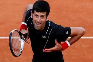 Novak Djokovic celebrates winning his French Open fourth round match against Spain