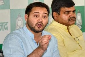 RJD leader Tejashwi Yadav speaks to the media during a press conference in Patna.