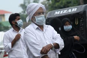 People wear safety masks as a precautionary measure after the Nipah virus outbreak, at Kozhikode Medical College in Kerala.