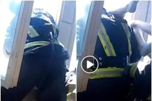 Firefighters rescue a suicidal man after he jumps out of the window (