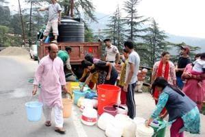 People filling water from a water tanker in Fagli, Shimla on June 1.