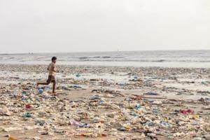 Plastic waste lies on the shore at Juhu Beach in Mumbai.