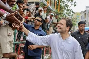 Congress President Rahul Gandhi greets his supporters during an election campaign rally ahead of Karnataka Assembly Elections 2018 in Bengaluru.