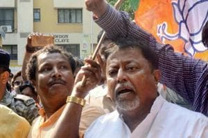 BJP leader Mukul Roy and others sits in a demonstration to protest against the violence during Panchayat polls