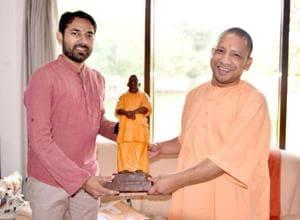 Yogi's OSDAbhishek Kaushik presented him with a miniature fibre statue of  Yogi Adityanath on his birthday.