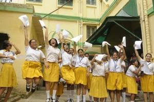 Students of St. Margaret School rejoice after the Madhyamik result in Kolkata, India, on Wednesday.