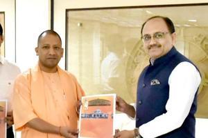Health minister Siddharth Nath Singh presenting the report to CMYogi Adityanath.