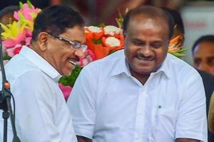Karnataka chief minister HD Kumaraswamy greets deputy chief minister G Parameshwara after oath-taking ceremony, in Bengaluru.