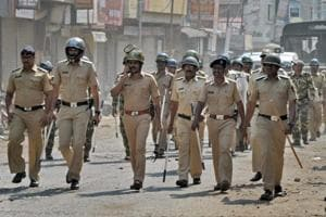 Police officials patrol streets after Dalits called for Maharashtra bandh to protest against Bhima Koregaon violence, at Sangli in Maharashtra.