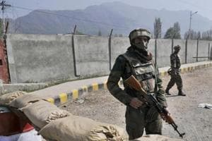 Indian Army soldiers stand guard near a check post outside Badami Bagh cantonment in Srinagar.