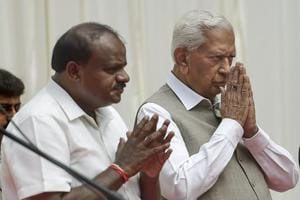 Karnataka governor Vajubhai Vala and chief minister HD Kumaraswamy during the swearing-in ceremony of newly inducted ministers during the first expansion of the JD(S) and Congress coalition government, at Rajbhavan in Bengaluru on Wednesday.