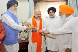 BJP president Amit Shah met Akali Dal patriarch and five-time chief minister Parkash Singh Badal and his son and party president Sukhbir Singh Badal in Chandigarh.
