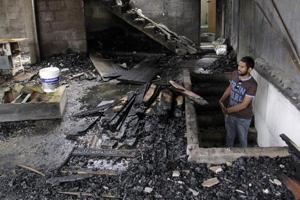 A man looks at a burnt home a day after anti-Muslim riots erupted in Digana, a suburb of Kandy, Sri Lanka on March 7, 2018