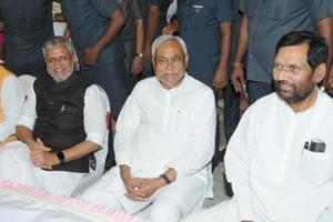 Bihar chief minister Nitish Kumar, his deputy Sushil Modi and Union minister Ram Vilas Paswan at the NDA dinner event in Patna on Thursday.