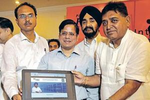 Industry and commerce minister Sunder Sham Arora launching 'Business First' portal in Jalandhar on Thursday.