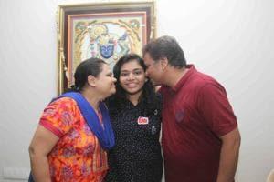 Khushi Ajay Vora, who scored 99.60% in Maharashtra SSC exam,  with her parents at Borivali in Mumbai on Friday.