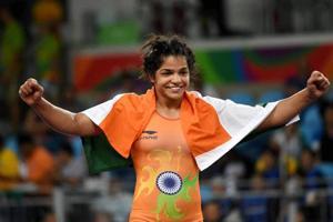 Wrestler Sakshi Malik celebrates after winning the bronze in women