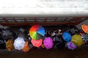 As middle-class aspirations are changing, people are spending less and less time in the rain, but spending more and more money on umbrellas.