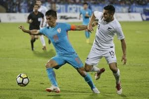 Indian soccer captain Sunil Chhetri, center, fights for the ball with Justin Gulley of New Zealand during the Hero Intercontinental Cup match in Mumbai, India, Thursday, June 7