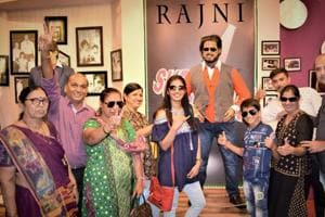 Visitors with film star Rajinikanth's wax figure at wax museum at Nahargah fort in Jaipur.