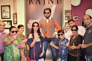 Visitors with film star Rajnikanth's wax figure installed at a wax museum in Nahargarh fort at Jaipur.