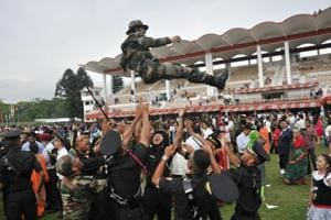 The newly commissioned officers toss a colleague up in air after the passing out parade of the gentleman cadets at IMA in Dehradun.