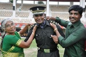 Rajshekhar with his mother and brother after the passing-out parade of the Indian Military Academy in Dehradun on Saturday.