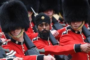 Guardsman Charanpreet Singh Lall of the Coldstream Guards wears a turban as he takes part in the Colonel