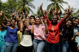 Students celebrate after SSC results were declared on Friday.