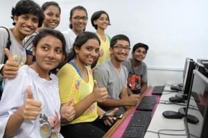 Students check their results, which were declared on Friday, for the Class 10 board exam conducted in March.