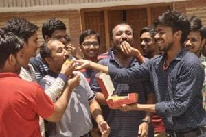 Sweets being offered at Anand Kumar's residence in Patna.  As many as 26 of the 30 students trained by famed coaching institute Super 30 have cleared the JEE-Advanced 2018 for admission to India's premiere IITs, its founder Anand Kumar said on Sunday.