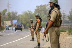 CRPF personnel keep vigil on Jammu-Srinagar National Highway,, near Nagrota in Jammu.