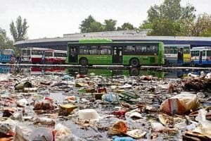 Water and garbage accumulated at the bus stand near Mahavir Chowk after four hours of moderate rain. Unlike the Hero Honda Chowk, the filth had not been cleared till Sunday afternoon, inconveniencing residents.