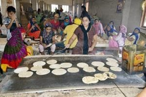 Devotees preparing chapattis in the langar hall at the Golden Temple in Amritsar.