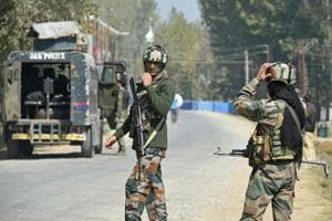 Paramilitary troopers stands guard after a gunfight with militants in Kashmir.