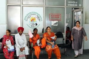 Patients and attendants await their turn for ultrasound scan tests at the civil hospital in Bathinda.