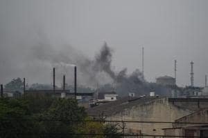 In this photograph taken on May 31, 2018, smoke rises from chimneys in an industrial area in Kanpur.