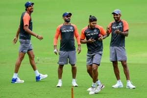 Indian cricket players Ishant Sharma, Dinesh Karthik, K L Rahul and Umesh Yadav at a fielding drill during a practice session ahead of the maiden cricket test match against Afghanistan, in Bangalore.
