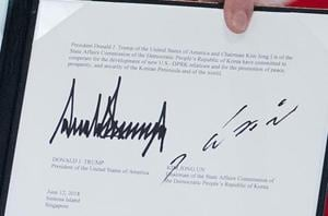 The signatures of US President Donald Trump (left) and North Korea