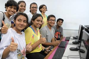 Students celebrate after checking their SSC results on June 8.
