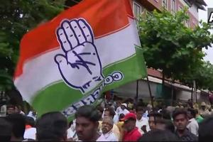 Congress workers celebrate outside counting centre in Bengaluru after party wins Jayanagar assembly seat.
