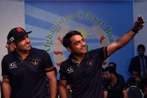 Afghan spinners Rashid Khan (R), Mohammed Nabi (L)and Mujeeb ur Rahman (not pictured) will no doubt be challenged by the transition from bowling with a white ball to the red ball.