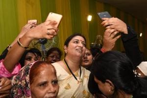Women click selfie with union textiles minister Smriti Irani at an Iftar party hosted by union minority affairs minister Mukhtar Abbas Naqvi at his residence in New Delhi on Wednesday.