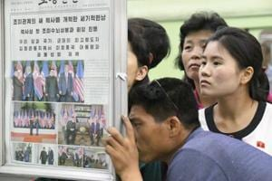 Commuters read reports of the meeting between Kim Jong Un and Donald Trump at a subway station in Pyongyang, North Korea, om Wednesday.