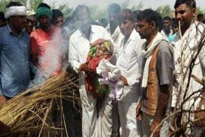 Hans Raj Gurjar's 15-day-old son lights his pyre at his native village in Mungalpur .